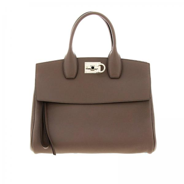 The Studio bag in genuine hammered leather with a Mediterranean hook-shaped closure