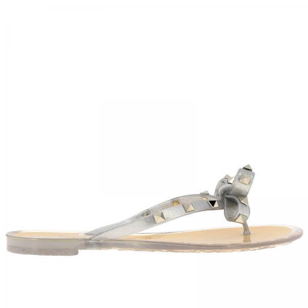 Sandalo Rockstud flat a infradito in PVC glitter con maxi fiocco