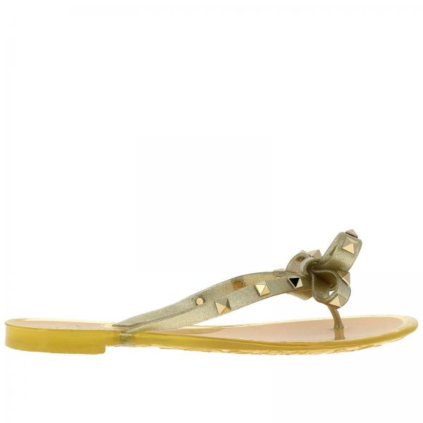 Rockstud flat sandal in glitter PVC with maxi bow