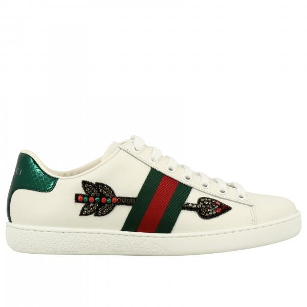 Gucci New Ace sneakers in leather with arrow-shaped patches, rhinestones and Web bands