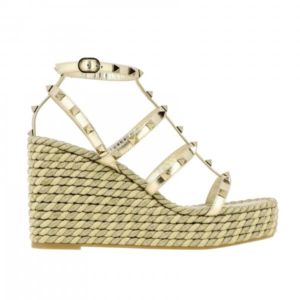 Valentino Garavani Rockstud wedge sandal in studded laminated leather