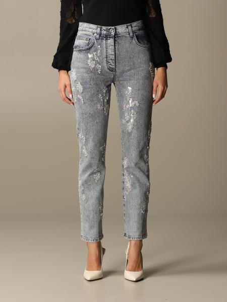 Blumarine: Blumarine jeans in used denim with rhinestones