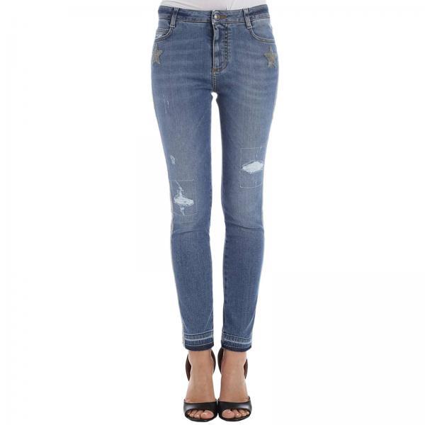 Jeans stretch used a vita bassa con rotture e bande laterali