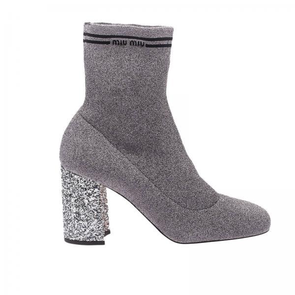 best cheap 7c408 debe0 Tronchetto a calza slip on in maglia tech lurex con logo e tacco scultura  glitter