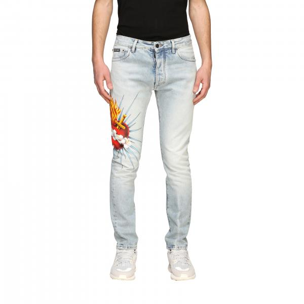 Jeans Palm Angels in denim used con stampa cuore trafitto