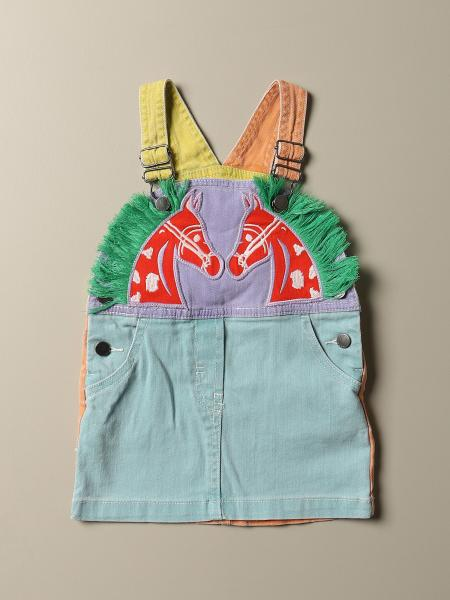 Dungaree dress in colored denim with horse patch