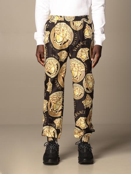 Versace: Versace nylon jogging trousers with all-over medusa heads