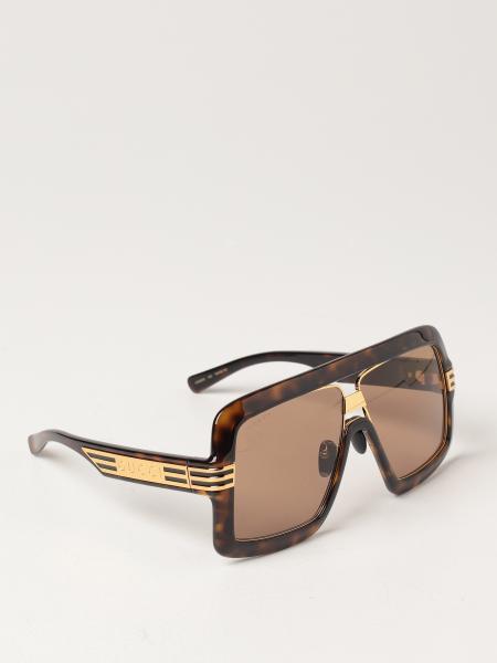 Gucci: Gucci sunglasses in tortoiseshell acetate
