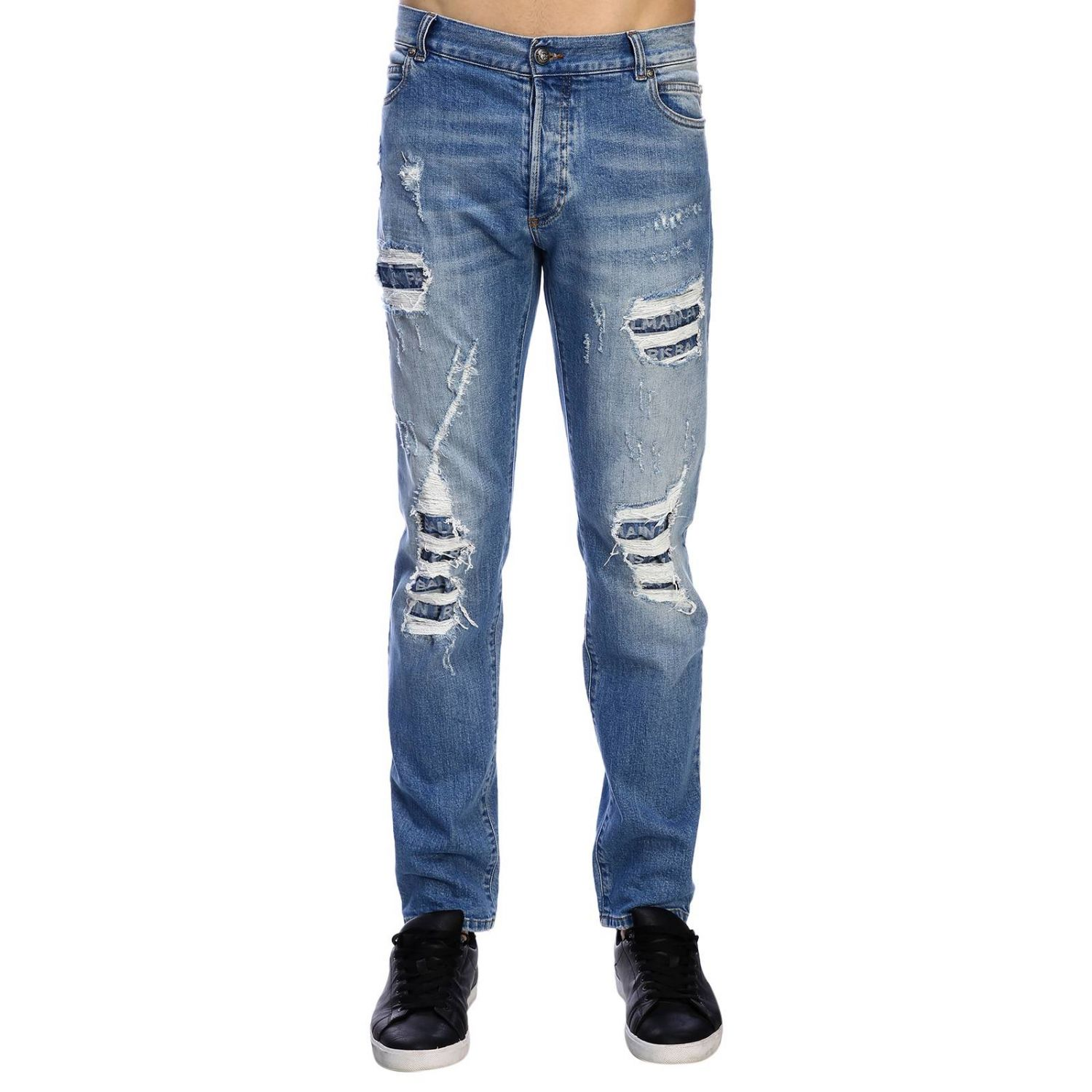 Jeans Balmain: Balmain slim fit jeans in used effect denim with maxi breaks and logoed patches stone washed 1