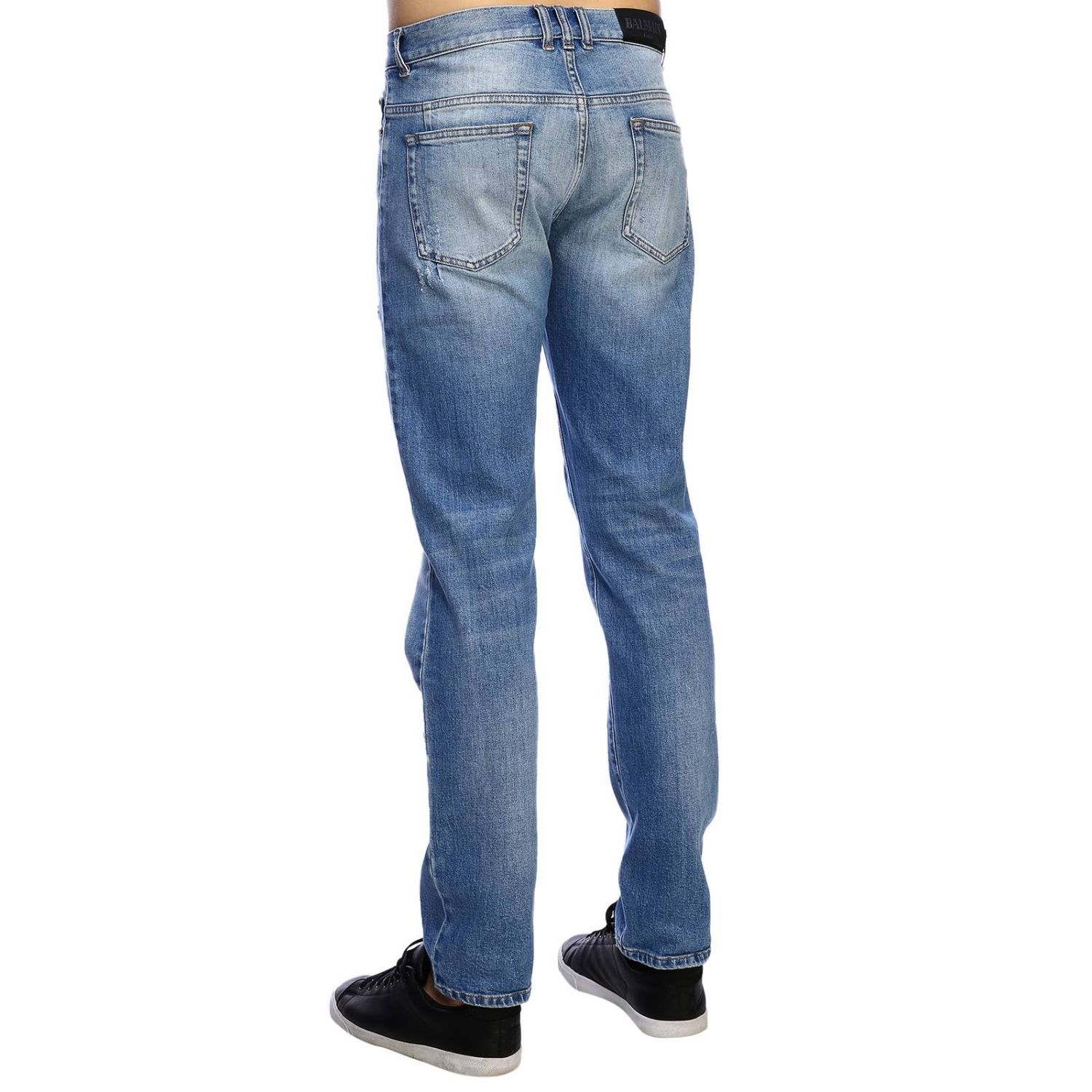 Jeans Balmain: Balmain slim fit jeans in used effect denim with maxi breaks and logoed patches stone washed 3