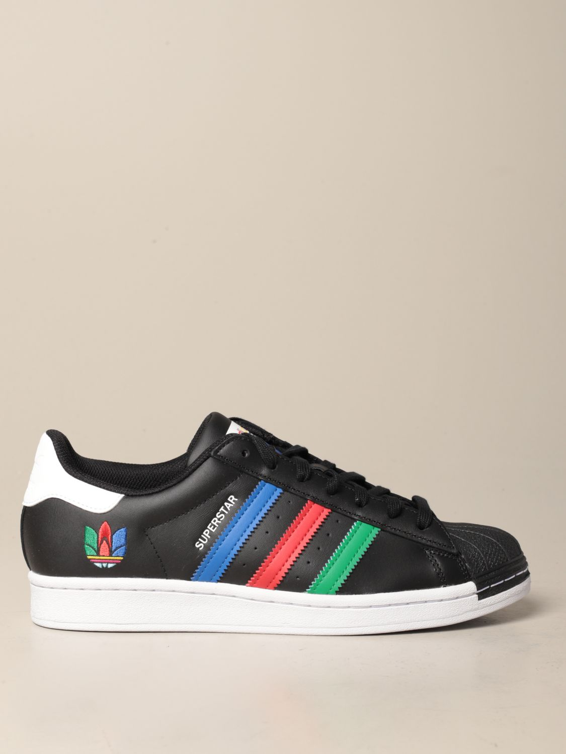 El aparato plataforma Enjuiciar  Adidas Originals Superstar sneakers in leather with multicolor clover |  Sneakers Adidas Originals Men Black | Sneakers Adidas Originals FU9520  Giglio EN