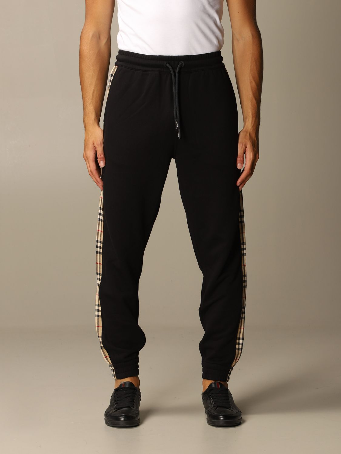 Pants Burberry: Burberry jogging trousers in cotton with check bands black 1