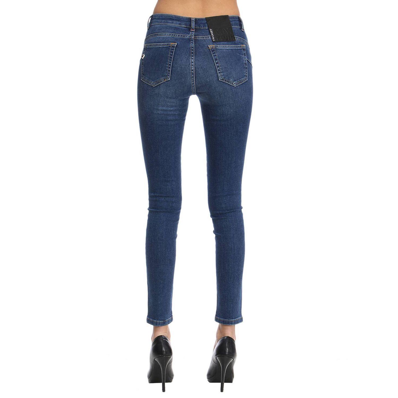 Jeans slim fit con maxi applicazioni di strass multicolor