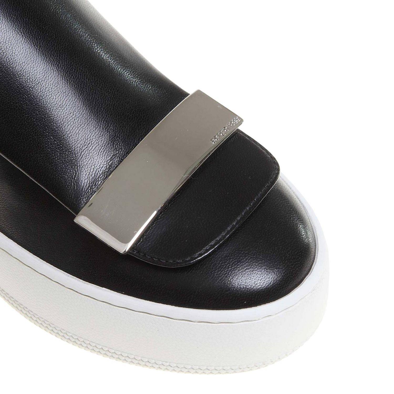 Спортивная обувь Sergio Rossi: Спортивные сапоги Sr1 Sergio Rossi из кожи и меха черный 3